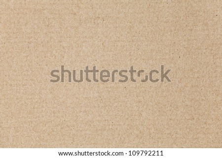 Flat brown cardboard background texture - stock photo