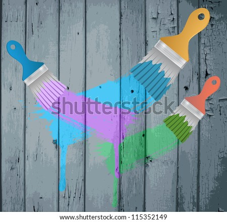 flat brushes with paint's splashes on a Colorful  Wooden Planks - stock photo
