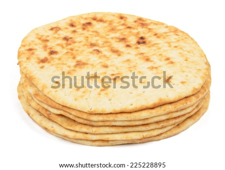 flat cakes arranged in a stack on white