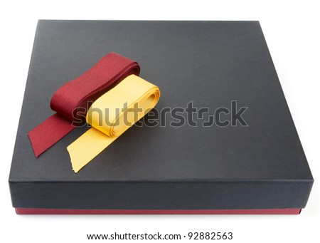Flat cardboard gift box isolated on white with two laces - stock photo