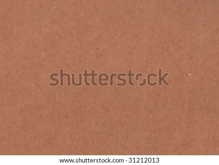 Flat cardboard surface with fiber texture. - stock photo