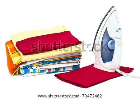Flat electric iron and clothes isolated on white background - stock photo