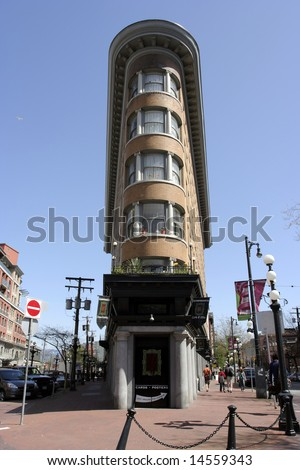 Flat Iron building Hotel Europa in Vancouver on Gastown square - stock photo