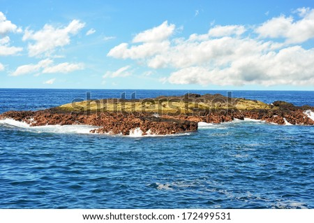 Flat lava rock formation just out of the Pacific ocean - stock photo