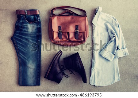 Flat lay of men's casual outfits, fashion on gray background, vintage tone