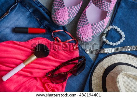 Flat lay of women's casual outfits with accessories on gray background