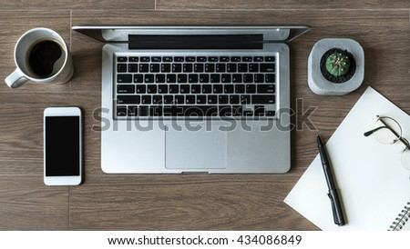 Flat Lay of Work Desk, Laptop, Coffee, Cactus, Folder, Notebook and Pen on Wood Background