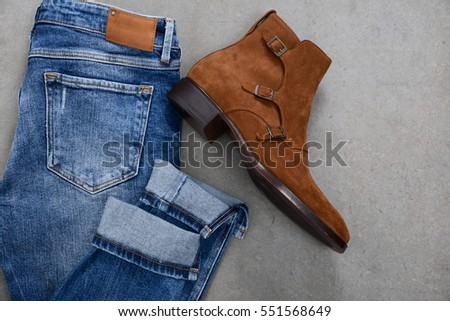 Flat lay picture of mans with jeans and shoes on gray