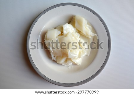 Flat noodle in dish - stock photo