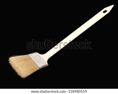 flat paint-brush isolated on black background - stock photo