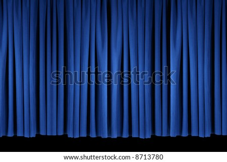 Flat Panel of Blue Stage Theater Drapes Lit With Stagelights - stock photo