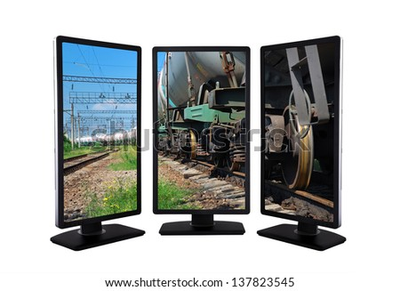 flat panels with train transports tanks on screen
