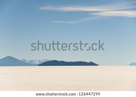 Flat salt surface in the desert Uyuni in Bolivia. - stock photo