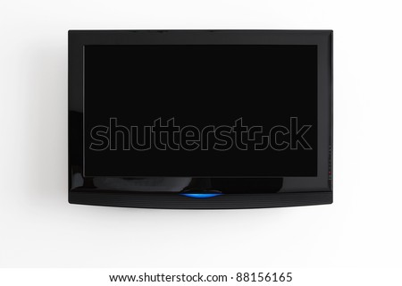 Flat screen LCD hanging at the wall with clipping path for the screen - stock photo