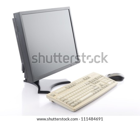 Flat screen LCD monitor with old keyboard and mouse on a white background - stock photo