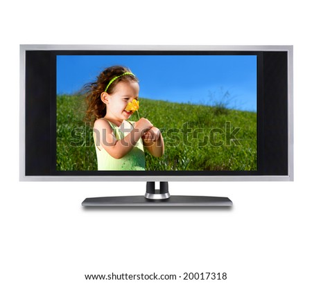 Flat screen tv with a little girl smelling a flower on the screen