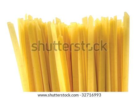 Flat tagliatelle spaghetti, isolated macro closeup pattern - stock photo