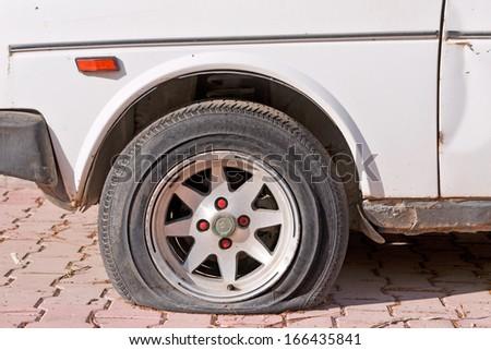 Flat tire - stock photo