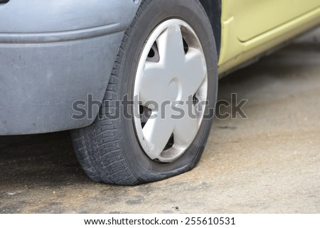 flat tire car - stock photo