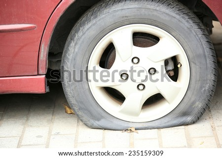 flat tire on car wheel  - stock photo