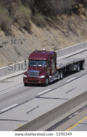 Flatbed Semi Truck on the Highway - stock photo