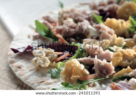 flatbread with tuna eggs and lettuce typical Italian food in northern Italy - stock photo
