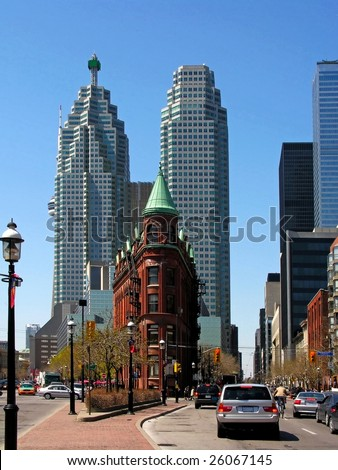 Flatiron Building Toronto with the BCE Place office towers in the background - stock photo