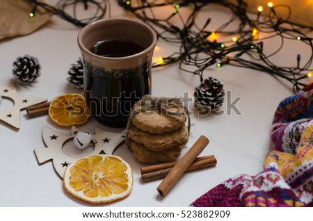 flatlay, Cookies, tea, bumps, background, orange, cinnamon, pine cones on a Christmas tree, white background, garlands, Christmas, knitted,