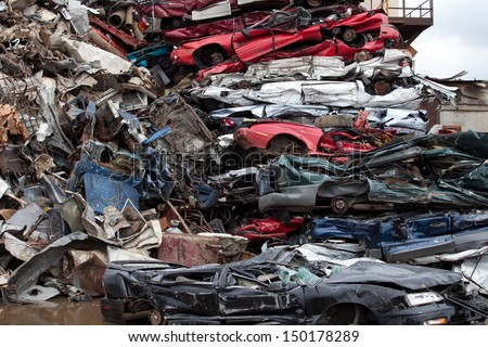 Flattened cars going to be shredded in a recycling facility - stock photo