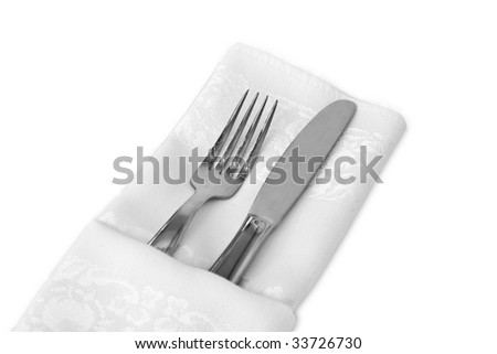 Flatware wrapped with a white linen napkin against a white background, has clipping path. - stock photo