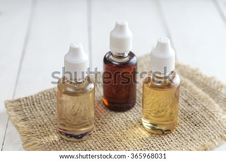 Flavor for electronic cigarettes  in different colors - stock photo
