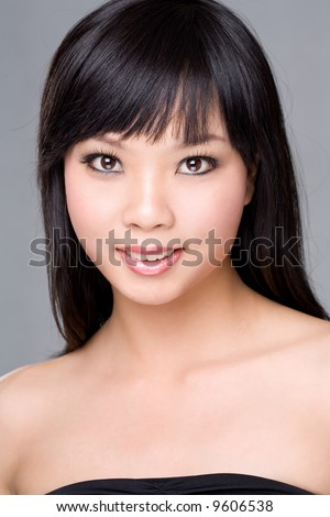 flawless face of an asian woman with brown eyes - stock photo