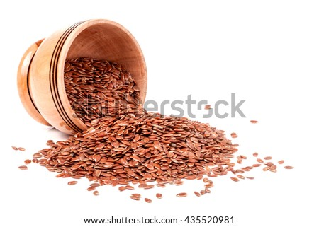 flax in a wooden bowl isolated on white background - stock photo