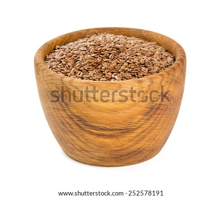 flax seed in a wooden bowl isolated on white - stock photo
