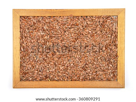 Flax seed in frame - stock photo