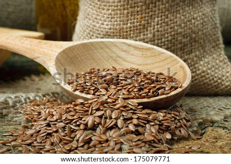 Flax seed (linseed) on wooden spoon - stock photo