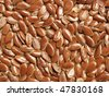 Flax seeds  - close up view, can be used as a background - stock photo