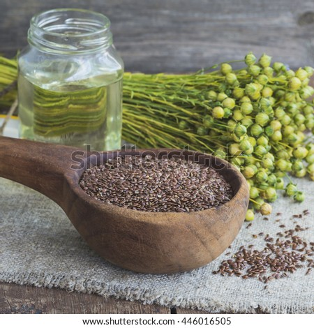 Flax seeds, flax and flaxseed oil on linen napkin .Selective focus - stock photo