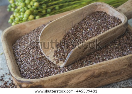 Flax seeds in a wooden bowl .Selective focus - stock photo