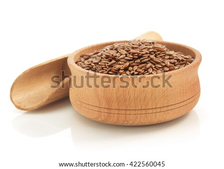 flax seeds in bowl isolated on white background - stock photo