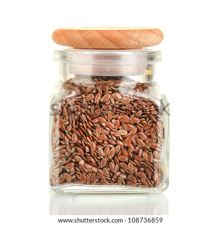 flax seeds in glass jar isolated on white - stock photo