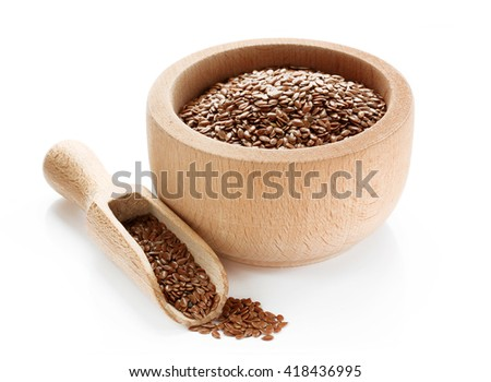 Flax seeds in wooden bowl isolated on white background - stock photo