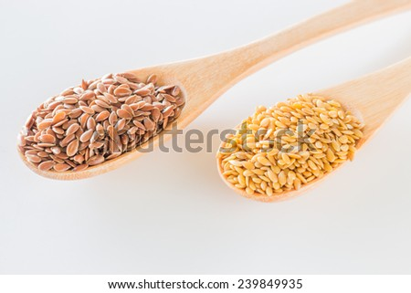 Flax seeds on wooden spoon, stock photo - stock photo
