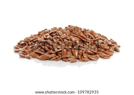 Flax seeds with reflection isolated on white background - stock photo