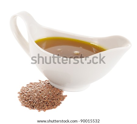 Flaxseed (Linseed) Oil and Flax Seeds Isolated on White Background - stock photo