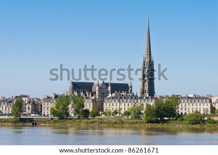 Fleche of Saint Michel as seen from the other shore of Garonne river on its way through Bordeaux, France - stock photo