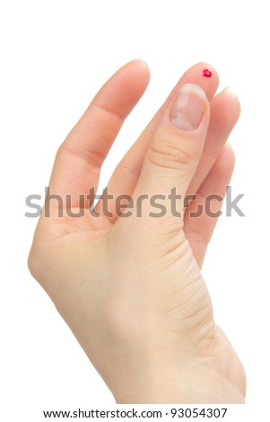 Flesh blood wound from diabetes patient finger to make glucose level blood test using ultra mini glucometer and small drop of blood isolated on a white background - stock photo