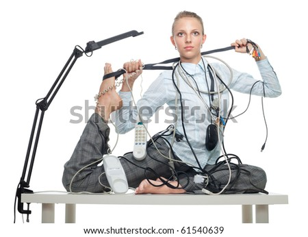Flexible business woman dealing with disorder that disturb her from work