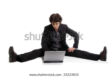 flexible business woman working on her laptop - stock photo