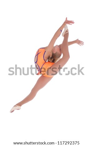 Flexible girl gymnast in a costume jumping anf doing split over white background